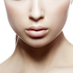 Part of beauty face of girl. Natural lips, nude make-up, clean skin.