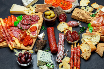 Italian meat appetizer snack set. Salami, prosciutto, bread, olives, capers