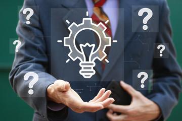 Businessman presses button idea gear engineering bulb icon question.