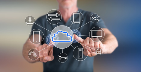 Man touching a cloud computing concept on a touch screen