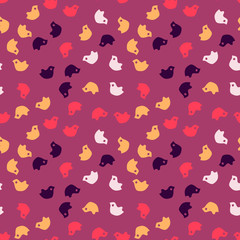 Bright colorful purple seamless pattern with simply cartoon red, orange, pink and violet birds chaotic placed at magenta background. Bright backdrop, print for clothes or wrapping paper