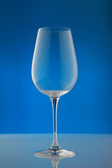empty wineglass/ empty wineglass on blue background