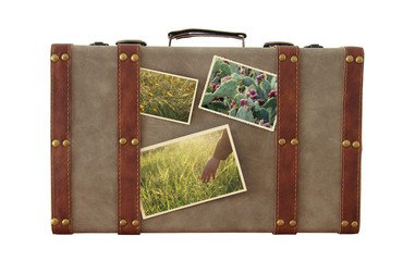 Image of old vintage luggage with nature photos isplated on white.