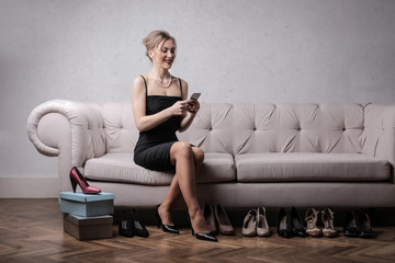 Elegant woman trying different shoes on