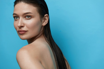 Beautiful Woman With Water Drops On Skin.