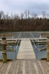 The wood dock boardwalk at the lake.