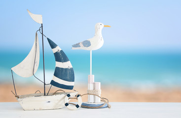 nautical concept with white decorative seagull bird and boat over tropical sea landscape background.