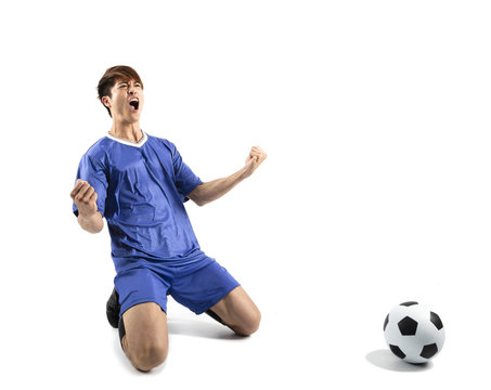 happy asian soccer player celebrating isolated on white.