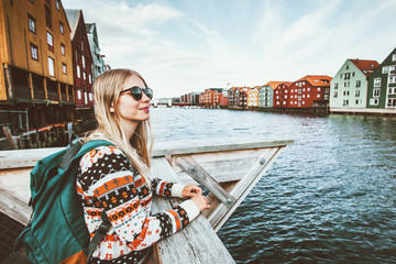 Young blonde woman traveling in Trondheim city Norway vacations weekend Lifestyle outdoor girl tourist with backpack sightseeing scandinavian architecture alone Fototapete