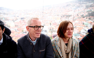 Edmond Offermann and his wife Maja Serdarevic are seen during a test drive of the Trebevic cable car following the restoration of the line after 26 years in Sarajevo