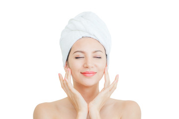 Portrait of beautiful woman smiling touching face with a towel on her head on white background with clipping path