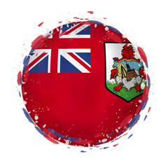 Round grunge flag of Bermuda with splashes in flag color.