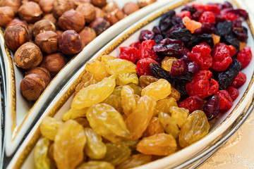bowl with mixed nuts and dried fruits such as raisins, almonds, hazelnuts and cashews.  Healthy food and snack