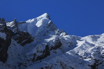 Mountain peak covered by glacier and snow. Scene in the Langtang National Park, Nepal.