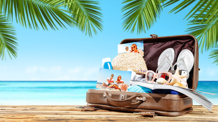 summer suitcase and beach background