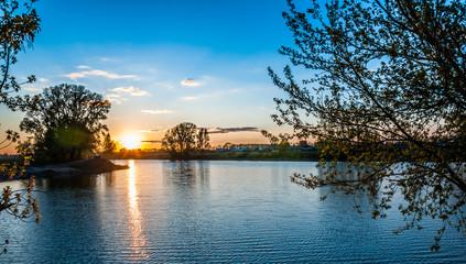 Nature landscape. Wonderful lake in sunset evening time