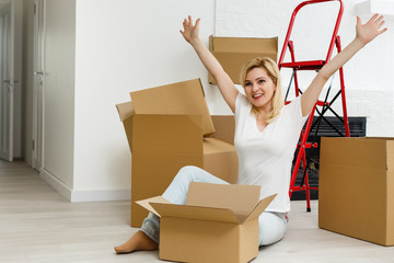 Young girl having fun while moving to new apartment moving newlyweds to new housing
