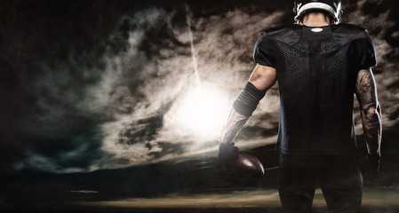 American football sportsman player over sky background. Sports banner and wallpaper with copyspace.