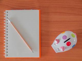 Top view , goals list with notebook , Piggy Bank.