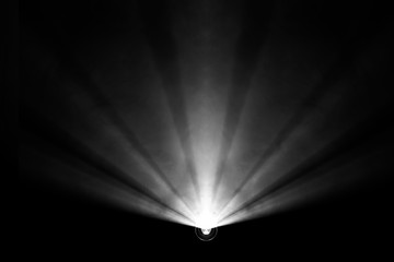 black and white color . projector beautiful spotlight . wide lens equipment for show presentation at night . smoke abstract background . digital monitor for multimedia teach .