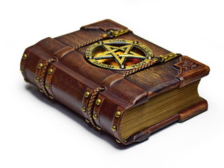 Vintage wooden - leather Grimoire book - laying on the table