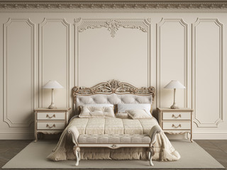 Classic bedroom furniture in classic interior.Walls with mouldings,ornated cornice