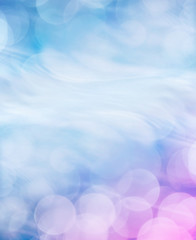 Fototapete - An abstract bokeh light background with a swirling motion effect and a subtle blue to magenta gradient.