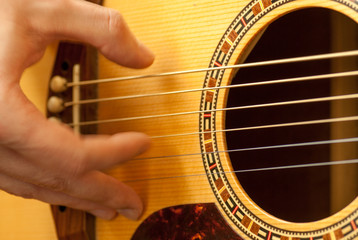 man hand playing acoustic guitar strings recreation concept
