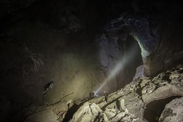 Underground ore gold mine tunnel drift with huge cavern cavity