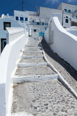 Traditional Greek stone stairway leading up to an island village