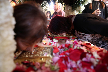 Greek Cypriot orthodox faithfuls kiss an icon at an Epitaph during a Good Friday mass at a church of Ayios Georgios Exorinos in Famagusta