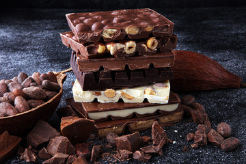 Chocolate bars on dark background with chocolate tower