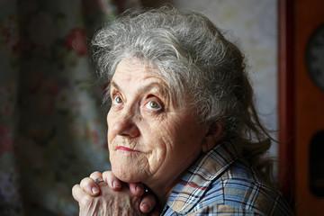 Sad and looking grandmother