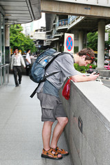 tourist is studying a map in Bangkok