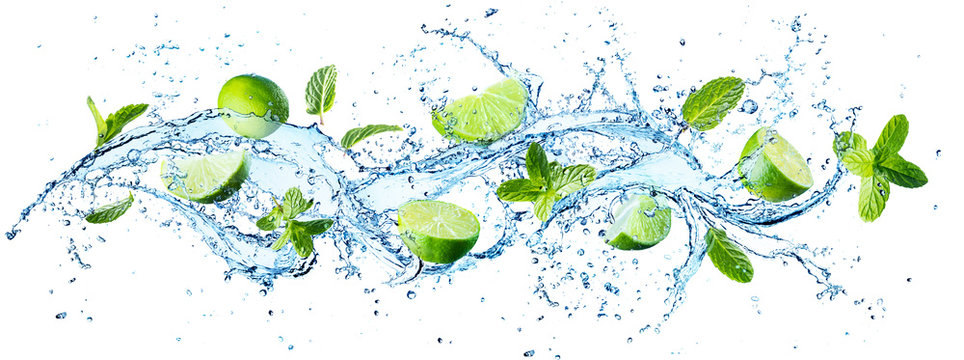 Water Splash With Mint Leaves And Slices Of Lime