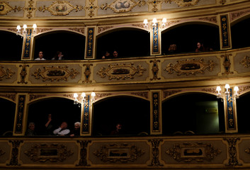 People sit in theatre boxes during an interval during the European Union Chamber Orchestra concert at the 12th International Spring Orchestra Festival at the Manoel Theatre in Valletta