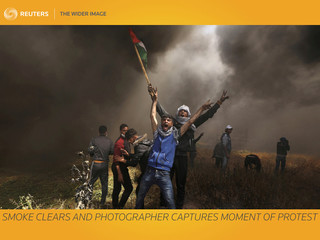 A picture and its story: Smoke clears and photographer captures momentÊof protest