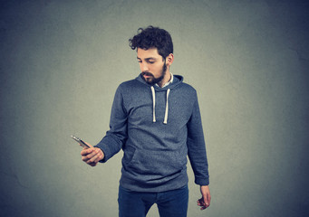 serious guy using a smartphone