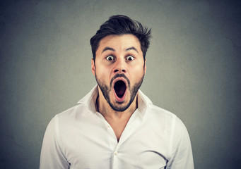 Super shocked man with mouth opened