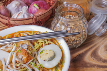 Curry Noddles or Mee Kari which is a popular traditional spicy noodle soup from the culture in Malaysia.
