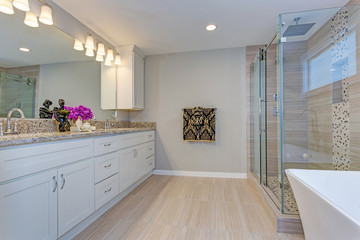 Light modern bathroom design with long white vanity cabinet