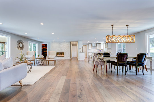 Spacious living and dining room with hardwood floor