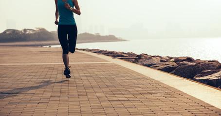 fitness sportswoman running on coast