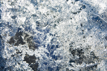 The texture of the ice. The frozen water.Winter background