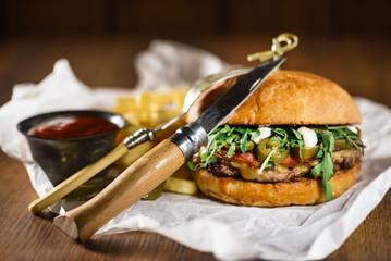 tasty burger with sauce