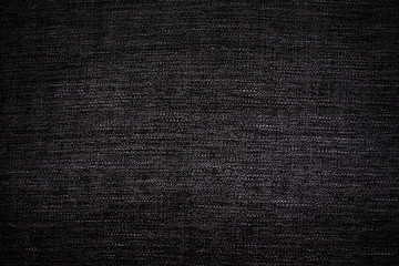 Native pattern on fabric in dark color tone background.