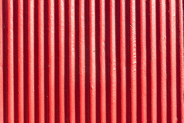 Red corrugated metal sheet background and texture surface