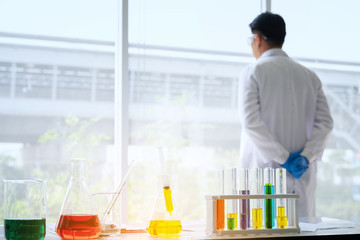 Blur focus Young male scientist standing in lab worker making medical research in modern laboratory.