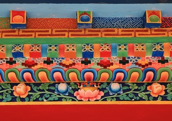 Colorful detail of monastry facade in Shyapru Bensi, Nepal. Beautiful painted fresko of a monastry in the Langtang  National Park, Nepal.