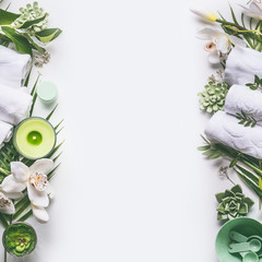 Photo sur Plexiglas Spa Green spa or wellness layout frame with towels, candle, tropical leaves , orchid flowers, succulents and body and face care tools and accessories on white background, top view.